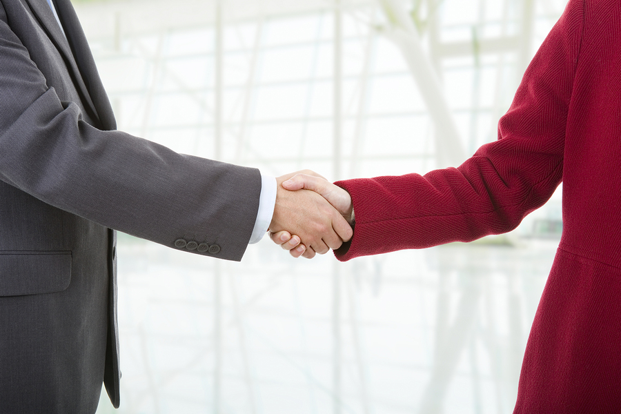 Two IT vendors shaking hands