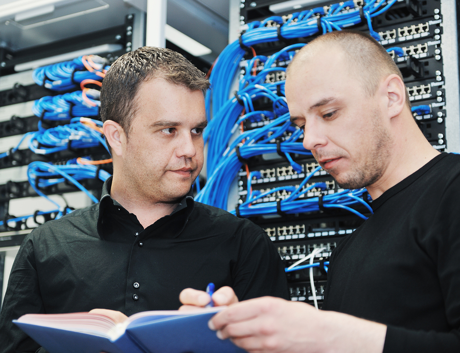 Two IT support engineers in a datacenter