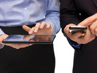 Working man on tablet and smartphone