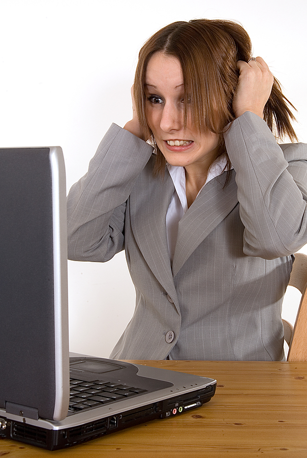 Frustrated woman at laptop who can't access her email