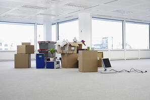 Empty office space with boxes and a desk - moving into a new office