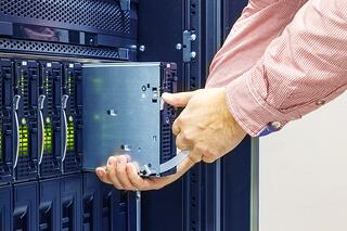 IT technician installing a server
